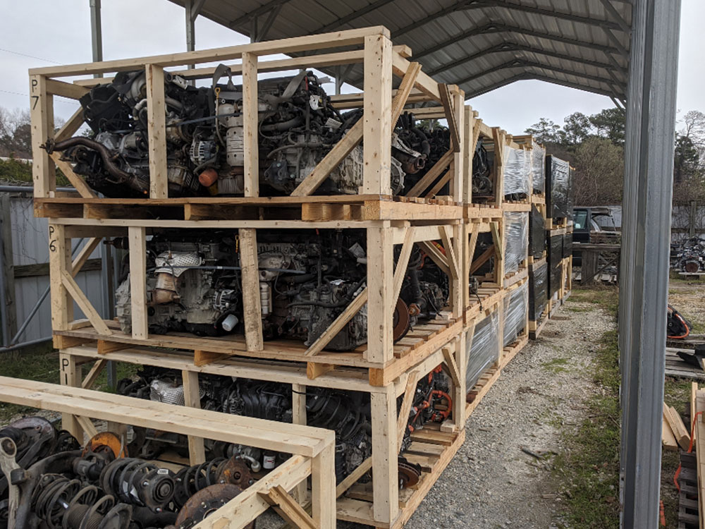 Mixed load of powertrain, sheet metal, suspension, and lamps ready for export shipping.